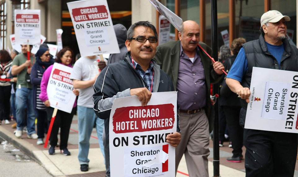 Thousands of striking Chicago hotel workers take over Magnificent Mile