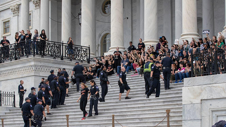 Amid protests and arrests, Senate puts Kavanaugh on Supreme Court