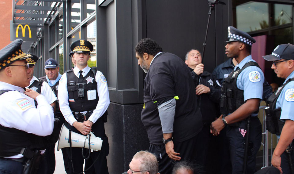 While being arrested at McDonald's workers demo, Rev. Barber gets 'genius grant'
