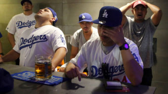 L.A. Dodgers cross picket line in Boston a day before World Series Game 1