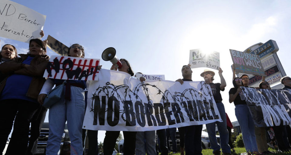Thousands protest at the border as Trump tours Texas wall site