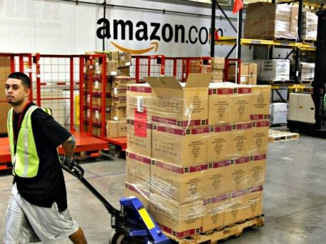https://www.peoplesworld.org/wp-content/uploads/2019/04/Amazon-Employee-Warehouse-Ross-D.-Franklin-file-AP-640x480-461x346.jpg