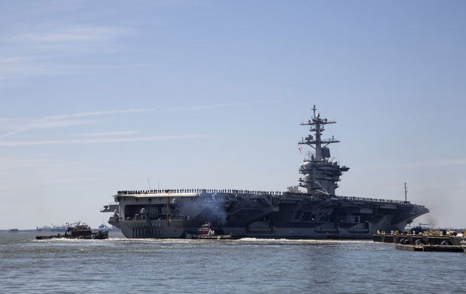 Trump sends aircraft carrier and strike force to threaten Iran