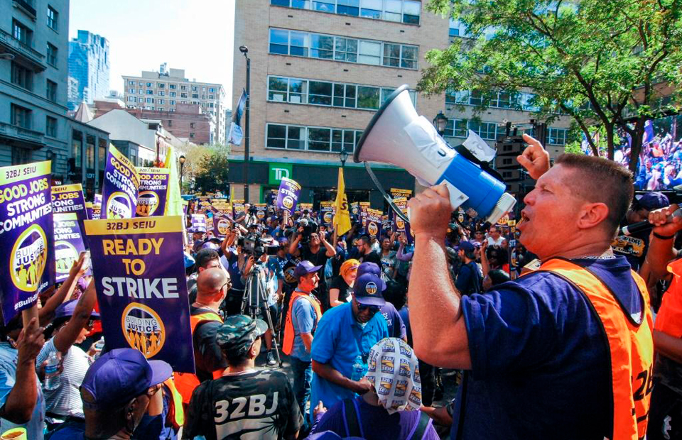 Low pay, lack of respect force janitors to march, maybe strike