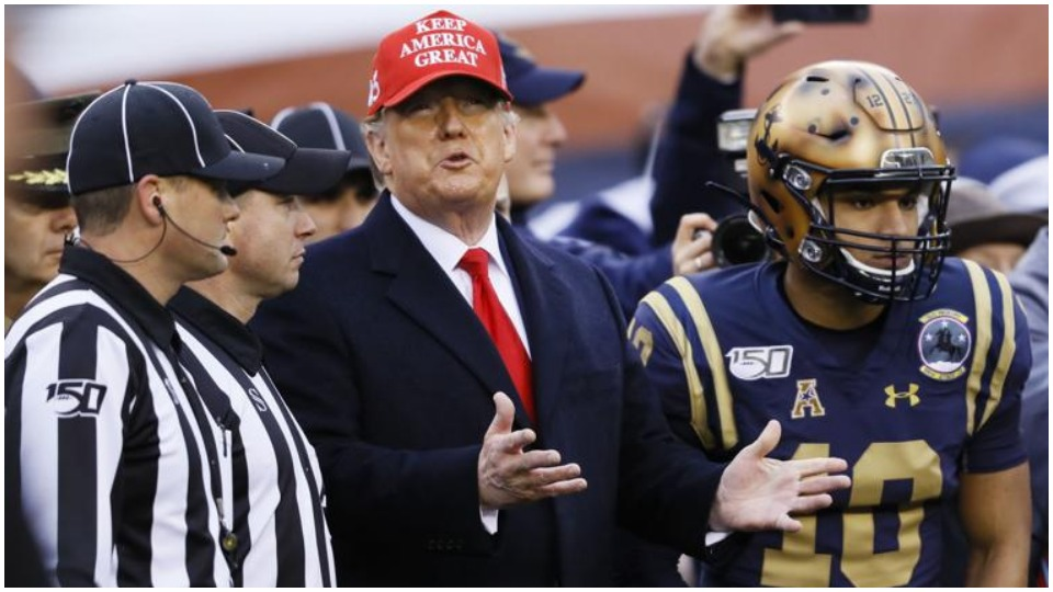 Can Trump pass up chance to cheer for war at college football championship?