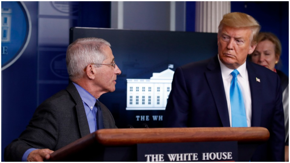 """Trump, pushing for May 1 """"re-opening,"""" attacks Dr. Fauci"""
