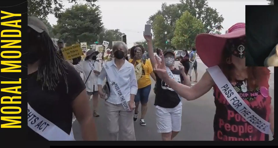 Honoring the suffragists, women in white march for voting rights