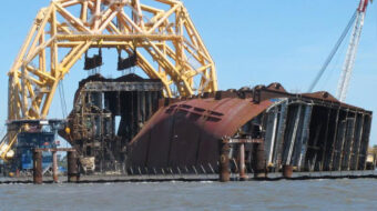 Oil spilled as section of overturned shipwreck separated